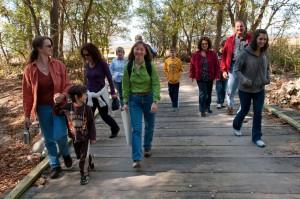 Hikers on bridge, T. Rollins